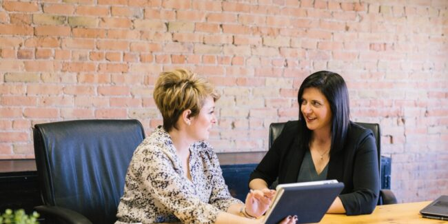 two women discussing Occupational Health and Safety Concerns