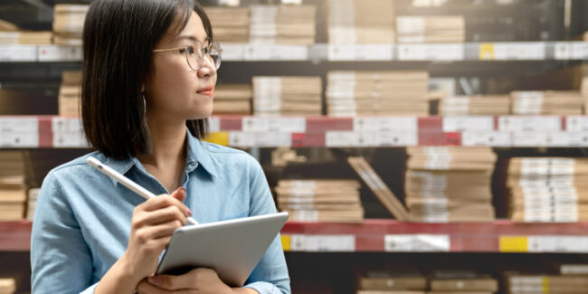 Quality professional using document control software in a warehouse